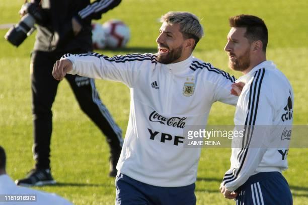 Argentina´s forwards Sergio Aguero and Lionel Messi attend a training session at Ciudad Deportiva Antonio Asensio in Palma de Mallorca on November...