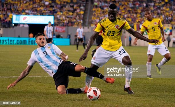 Argentina's foward Mauro Icardi vies for the ball with Colombia's defender Davinson Sanchez during the international friendly match between Colombia...