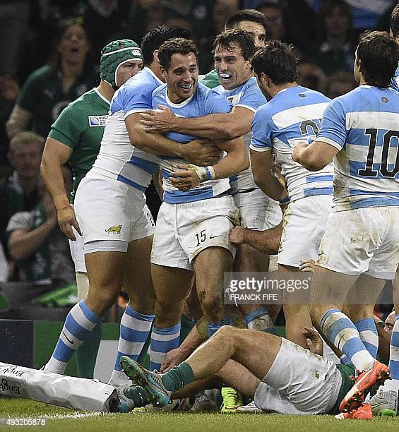 Argentina's fullback Joaquin Tuculet celebrates with teammates after scoring his team's third try during a quarter final match of the 2015 Rugby...