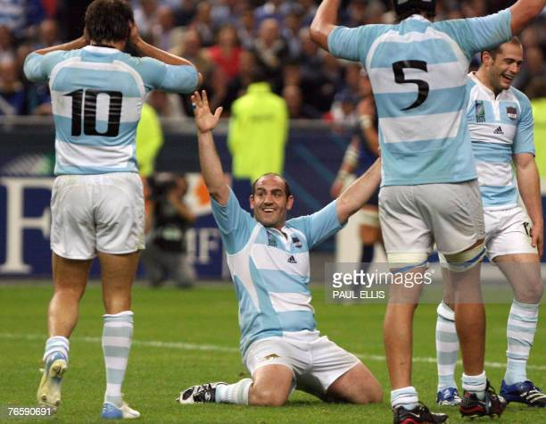 Argentina's fullback Juan Martin Hernandez hooker Mario Ledesma and lock Patricio Albacete jubilate after winning the rugby union World Cup opening...