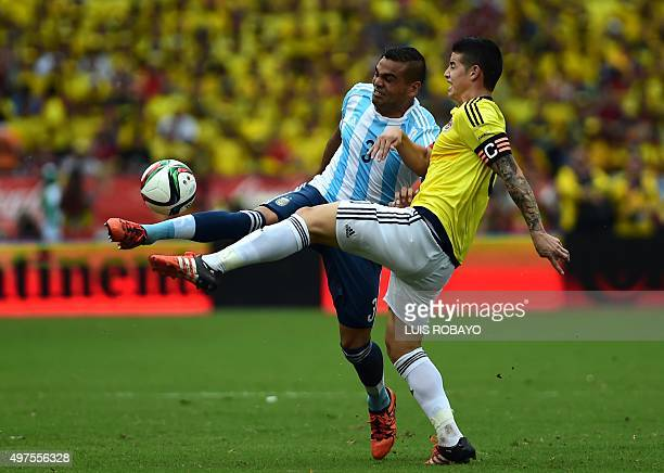 Argentina's Gabriel Mercado and Colombia's James Rodriguez vie for the ball during their Russia 2018 FIFA World Cup South American Qualifiers...