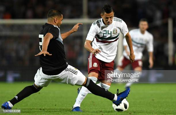 Argentina's Gabriel Mercado vies for the ball with Mexico's Roberto Alvarado during their friendly football match at Malvinas Argentinas stadium in...