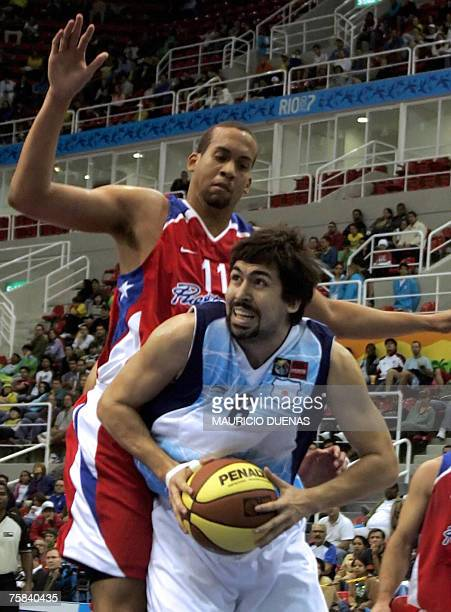 Argentina's Gabriel Mikulas drives to the basket marked by Puerto Rican Ricardo Sanchez during their XV Pan American Games Rio2007 28 July 2007 in...
