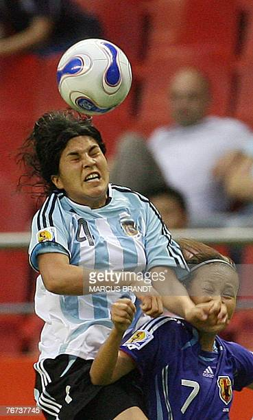 Argentina's Gabriela Chavez fights for the ball with Japan's Tomomi Miyamoto during their 2007 FIFA Women's World Cup football tournament Group A...