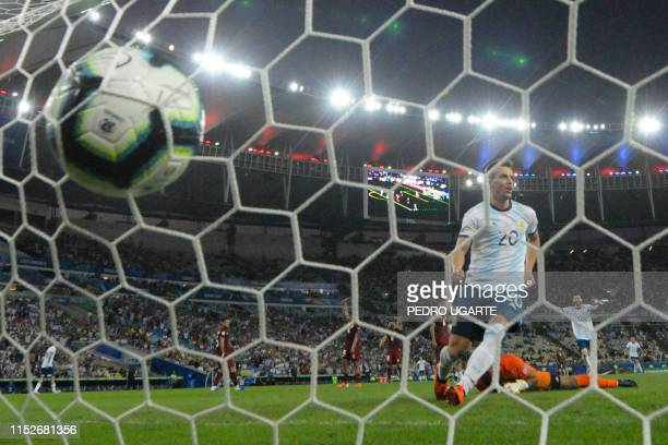 TOPSHOT Argentina's Giovani Lo Celso celebrates after scoring past Venezuela's goalkeeper Wuilker Farinez during their Copa America football...