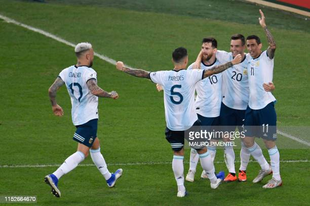 Argentina's Giovani Lo Celso celebrates with teammates after scoring against Venezuela during their Copa America football tournament quarterfinal...