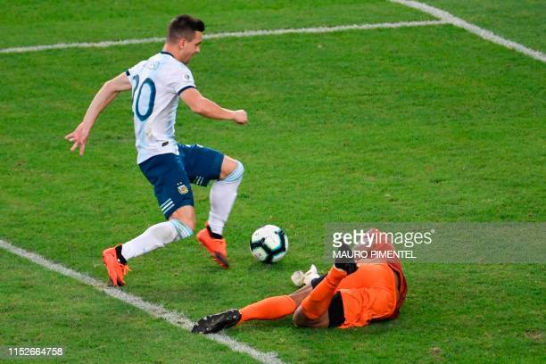 TOPSHOT Argentina's Giovani Lo Celso scores past Venezuela's goalkeeper Wuilker Farinez during their Copa America football tournament quarterfinal...