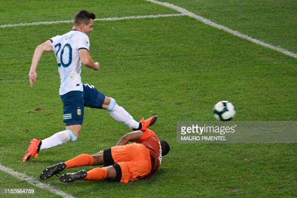 Argentina's Giovani Lo Celso scores past Venezuela's goalkeeper Wuilker Farinez during their Copa America football tournament quarterfinal match at...