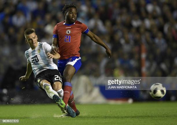 Argentina's Giovani Lo Celso strikes the ball past Haiti's Bryan Chevreuil during their international friendly football match at Boca Juniors'...