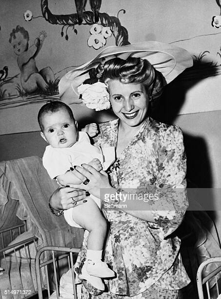 Argentina's Glamorous First Lady Makes a Friend Rome ItalY Eva Duarte Peron wife of the President of Argentina poses prettily with a baby she picked...