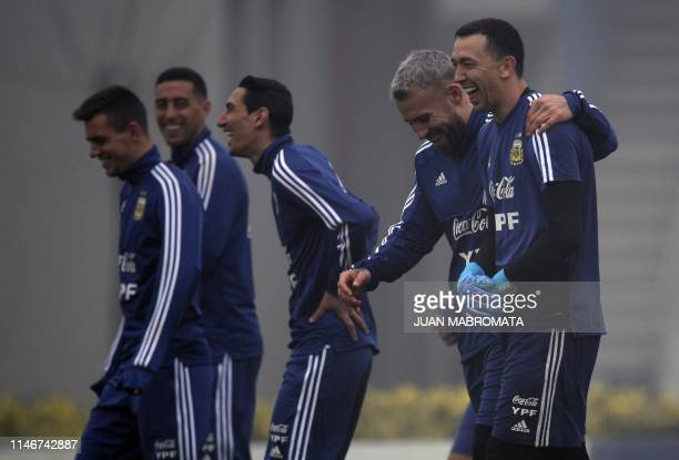 Argentina's goalkeeper Agustin Marchesin and defender Nicolas Otamendi laugh during a training session of the national team in Ezeiza Buenos Aires on...