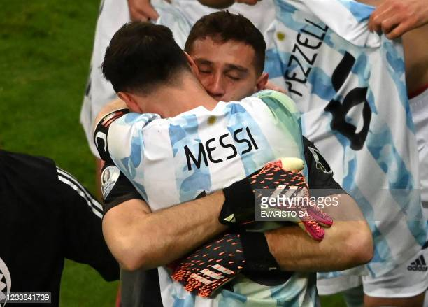 Argentina's goalkeeper Emiliano Martinez and Argentina's Lionel Messi celebrate at the end of the Conmebol 2021 Copa America football tournament...