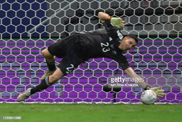 Argentina's goalkeeper Emiliano Martinez stops the ball during the penalty shootout of their Conmebol 2021 Copa America football tournament...