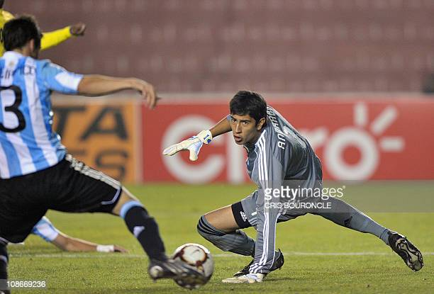 Argentina's goalkeeper Esteban Andrada reacts to a shot during a second round match of the Under20 South American championship against Ecuador held...