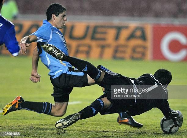 Argentina's goalkeeper Esteban Andrada stops the advance of Uruguay's midfielder Luis Machado during their South American Under20 championship...