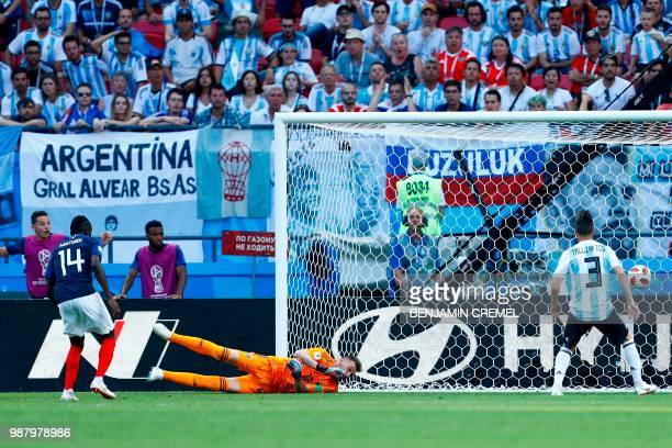 Argentina's goalkeeper Franco Armani concedes a third goal to France during the Russia 2018 World Cup round of 16 football match between France and...