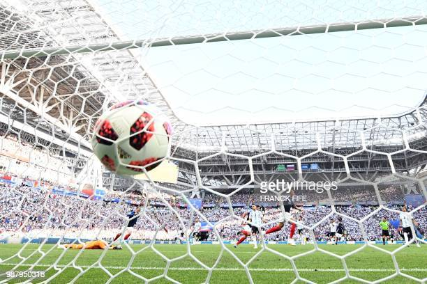 Argentina's goalkeeper Franco Armani dives and takes a fourth goal during the Russia 2018 World Cup round of 16 football match between France and...