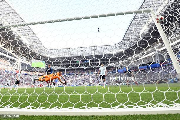Argentina's goalkeeper Franco Armani dives and takes a second goaltheir second goal during the Russia 2018 World Cup round of 16 football match...