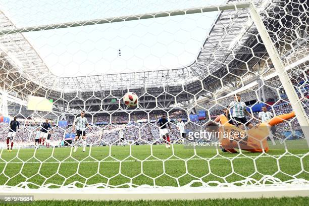 Argentina's goalkeeper Franco Armani dives and takes a third goal during the Russia 2018 World Cup round of 16 football match between France and...