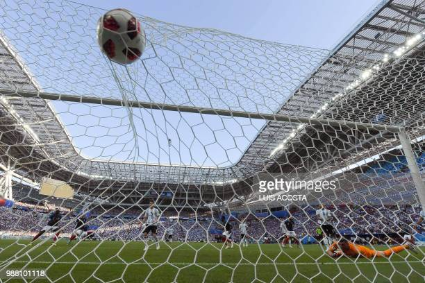 Argentina's goalkeeper Franco Armani eyes the ball after conceding the fourth goal to France during the Russia 2018 World Cup round of 16 football...