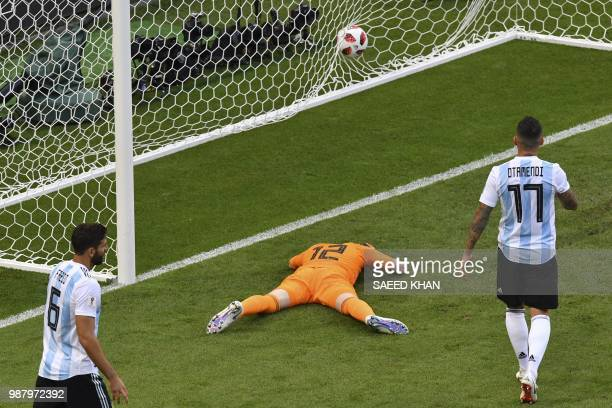 TOPSHOT Argentina's goalkeeper Franco Armani reacts as he takes France's third goal during the Russia 2018 World Cup round of 16 football match...