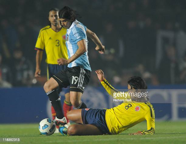 Colombia's Abel Aguilar struggle for the ball with Ever Banega of Argentina during 2011 Copa America soccer match as part of Group A at Brigadier...