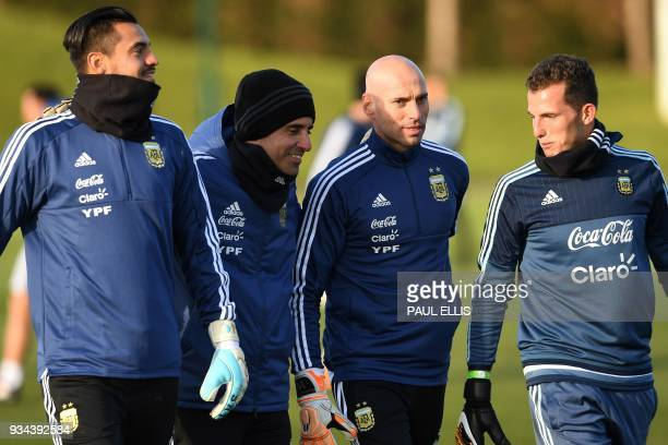 Argentina's goalkeeper Sergio Romero and Argentina's goalkeeper Willy Caballero participates in a team training session at the City Academy training...