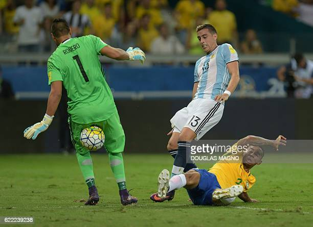 Argentina's goalkeeper Sergio Romero and Ramiro Funes Mori vie for the ball with Brazil's Gabriel Jesus during their 2018 FIFA World Cup qualifier...