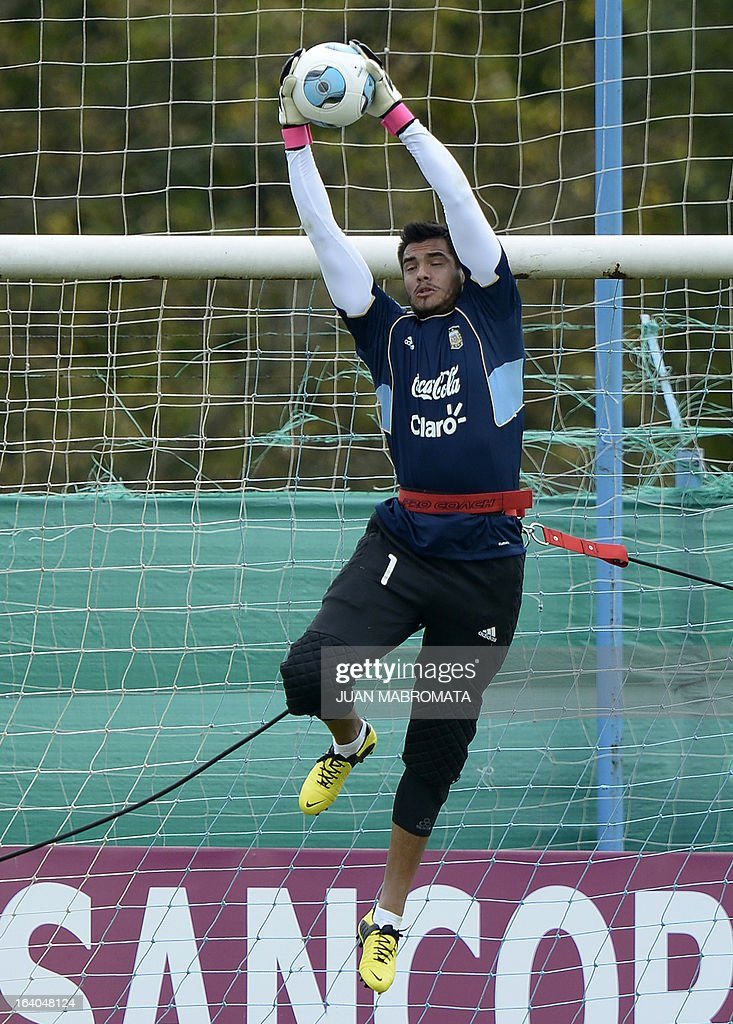 Argentina's goalkeeper Sergio Romero catches a ball during a training session in Ezeiza, Buenos Aires on March 19, 2013 ahead of the Brazil 2014 FIFA World Cup South American qualifier football mat...