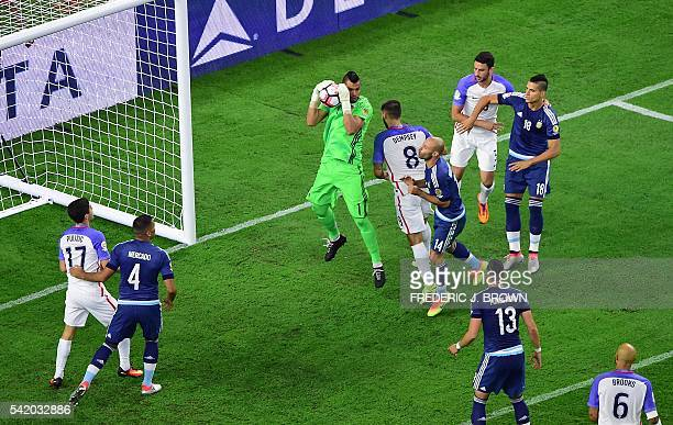 Argentina's goalkeeper Sergio Romero catches the ball during a Copa America Centenario semifinal football match against the USA in Houston Texas...