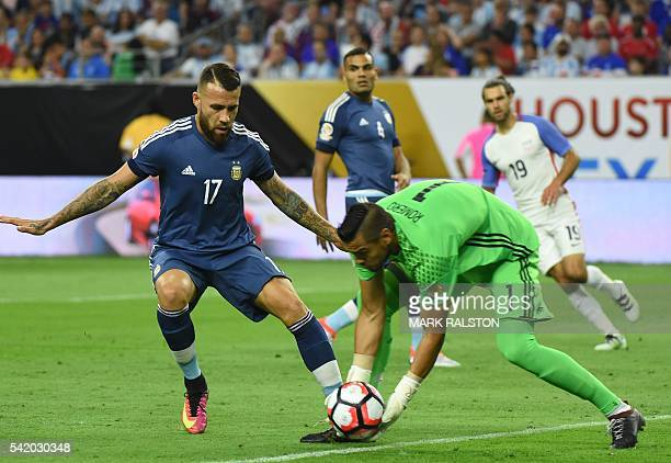 Argentina's goalkeeper Sergio Romero catches the ball during the Copa America Centenario semifinal football match against USA in Houston Texas United...
