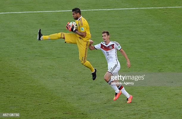Argentina's goalkeeper Sergio Romero challenges with Klose of Germany during the final of the FIFA World Cup 2014 between Germany and Argentina at...