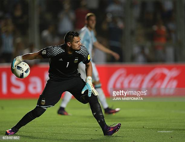 Argentina's goalkeeper Sergio Romero clears the ball during their 2018 FIFA World Cup qualifier football match against Colombia in San Juan Argentina...