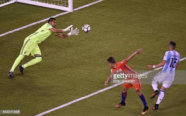 Argentina's goalkeeper Sergio Romero eyes the ball before catching a header by Chile's Eduardo Vargas during the Copa America Centenario final in...