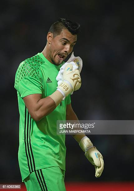 Argentina's goalkeeper Sergio Romero gestures during their Russia 2018 World Cup football qualifier match against Paraguay in Cordoba Argentina on...