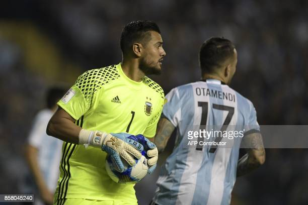 Argentina's goalkeeper Sergio Romero holds the ball during the 2018 World Cup qualifier football match against Peru in Buenos Aires on October 5 2017...