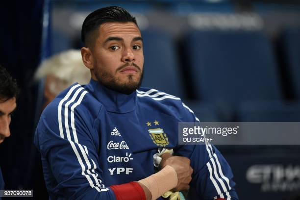 Argentina's goalkeeper Sergio Romero is pictured during warm up ahead of the International friendly football match between Argentina and Italy at the...