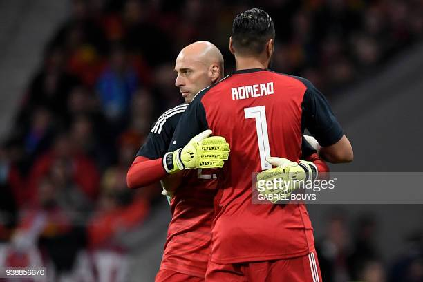 Argentina's goalkeeper Sergio Romero is replaced by Argentina's goalkeeper Willy Caballero after getting injured during a friendly football match...
