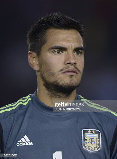 Argentina's goalkeeper Sergio Romero looks on before the Brazil 2014 World Cup South American qualifier football match against Peru at the Monumental...