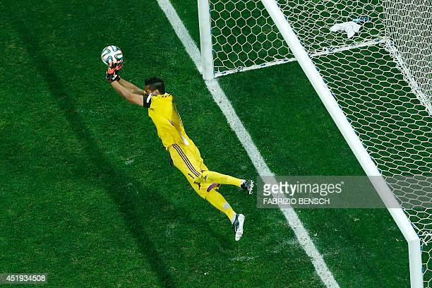 Argentina's goalkeeper Sergio Romero makes a save against Netherlands' midfielder Wesley Sneijder during penalty shootouts following extra time...