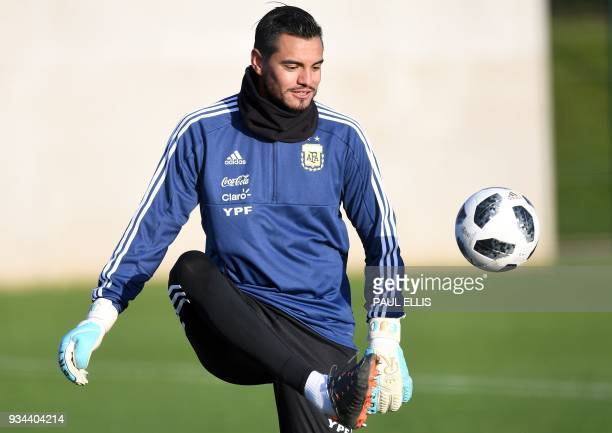 Argentina's goalkeeper Sergio Romero participates in a team training session at the City Academy training complex in Manchester north west England on...