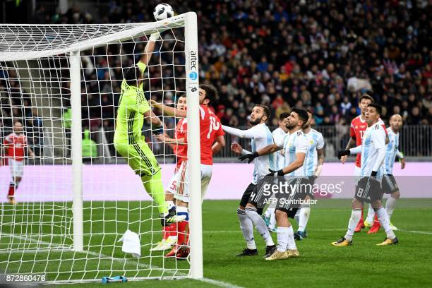Argentina's goalkeeper Sergio Romero punches ther ball away during an international friendly football match between Russia and Argentina at the...