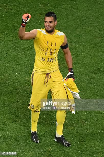 Argentina's goalkeeper Sergio Romero reacts after Argentina won the semifinal football match between Netherlands and Argentina of the FIFA World Cup...