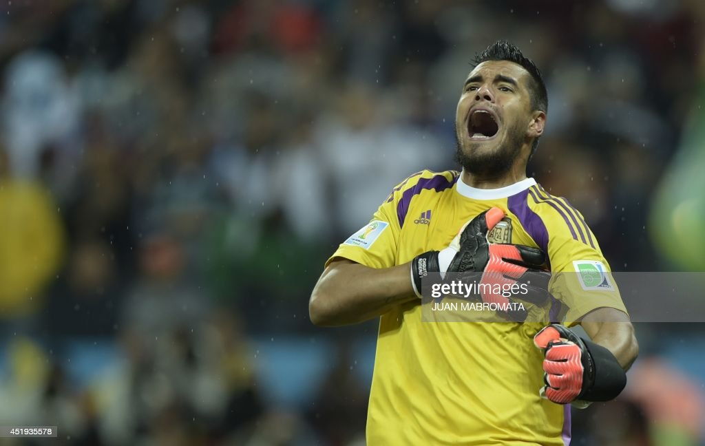 Argentina's goalkeeper Sergio Romero reacts after saving a penalty during penalty shoot-outs following extra time during the semi-final football match between Netherlands and Argentina of the FIFA World Cup at The Corinthians Arena in Sao Paulo on July 9, 2014. AFP PHOTO / JUAN MABROMATA / AFP PHOTO / Juan MABROMATA