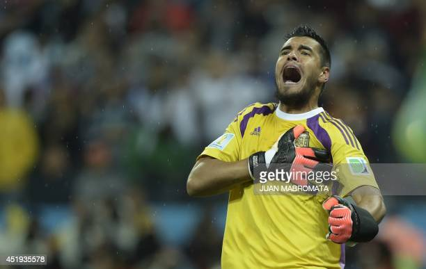 Argentina's goalkeeper Sergio Romero reacts after saving a penalty during penalty shootouts following extra time during the semifinal football match...