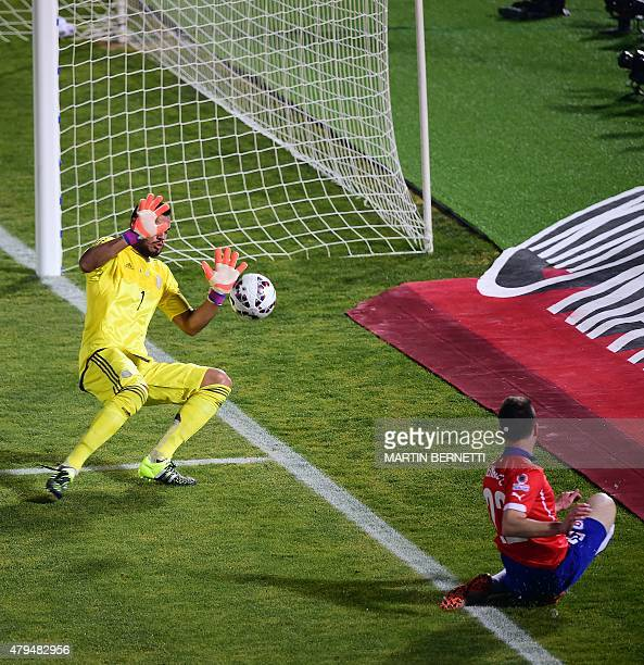 Argentina's goalkeeper Sergio Romero saves a shot by Chile's forward Angelo Henriquez during their 2015 Copa America football championship final in...