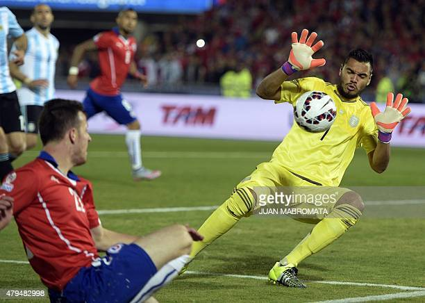 Argentina's goalkeeper Sergio Romero savesa a shot by Chile's forward Angelo Henriquez during their 2015 Copa America football championship final in...