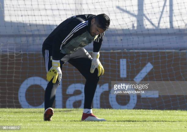 Argentina's goalkeeper Sergio Romero stretches during a training session in Ezeiza Buenos Aires on May 22 2018 Sergio Romero injured his right knee...