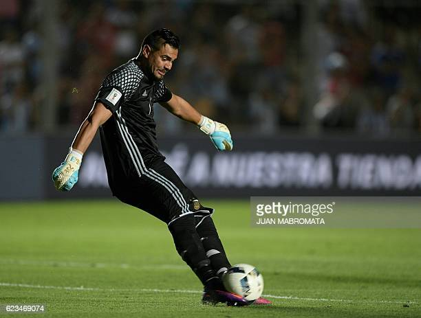 Argentina's goalkeeper Sergio Romero strikes the ball during the 2018 FIFA World Cup qualifier football match against Colombia in San Juan Argentina...