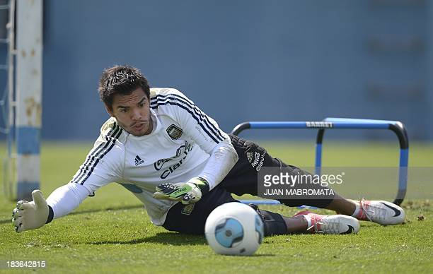 Argentina's goalkeeper Sergio Romero trains in Ezeiza Buenos Aires on October 8 2013 ahead of their Brazil 2014 World Cup South American qualifier...